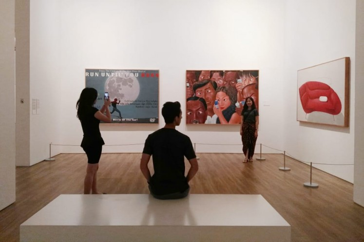 Visitors enjoying artworks in the museum