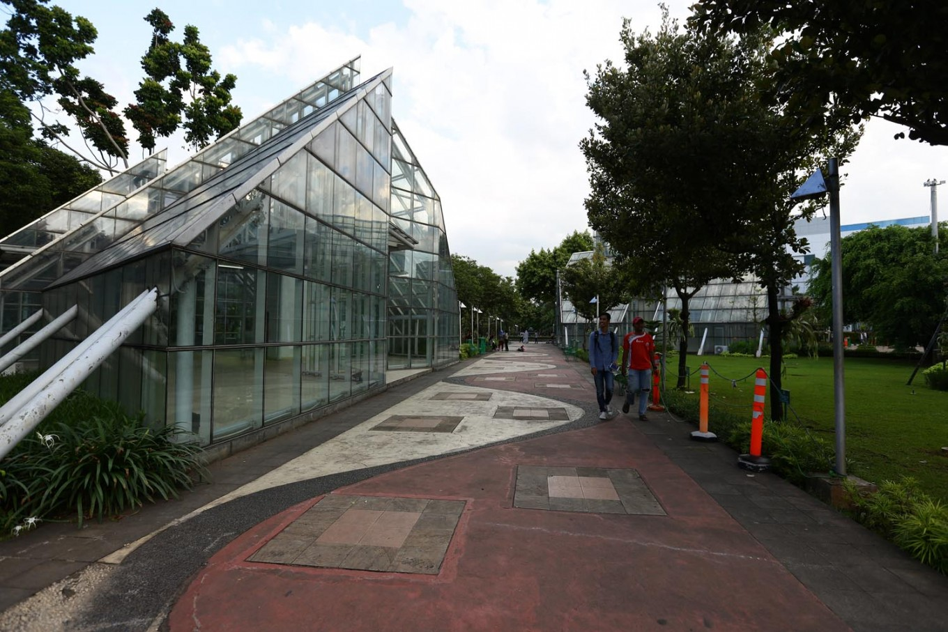 One of the greenhouses (left) at Taman Menteng.