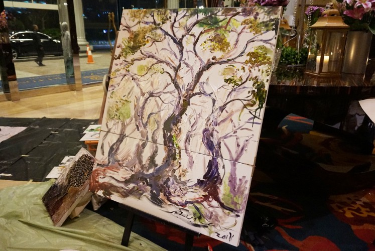 M. Ruslan's painting created during Earth 'ART' Hour on Saturday consists of two canvases that complement each other to symbolize the wholeness of nature