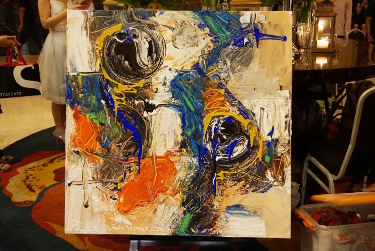 Painting created by Joko Kisworo during Earth 'ART' Hour on Saturday at The Ritz-Carlton Jakarta in Mega Kuningan, South Jakarta.