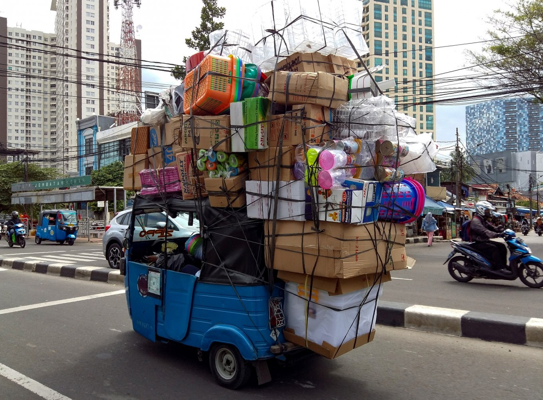 Ride-hailing apps run Indonesian bajaj taxis off road