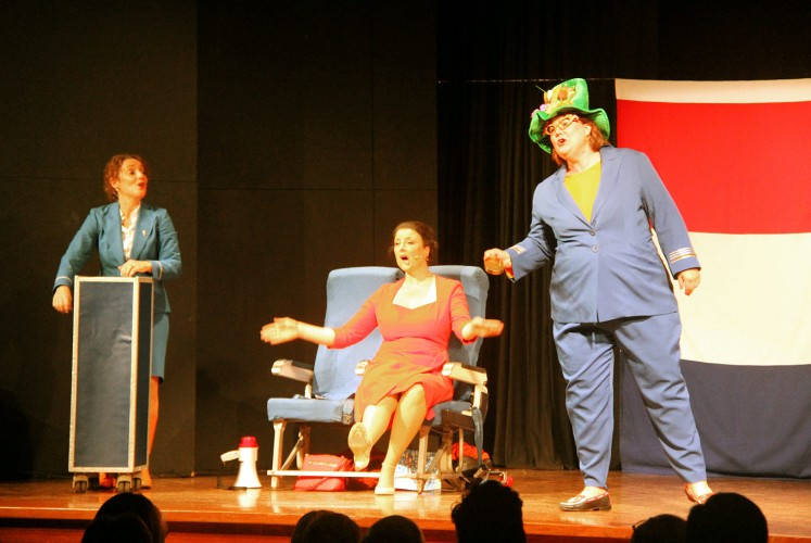 Comical: Dutch actresses Mechteld Schelberg (left) and Anna Nicolai (right), along with British guest artist Camilla van Doorn, perform a play about the Dutch people.