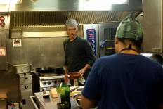Iron chef: The ship's chef Daniel (left), prepares food in his galley. JP/Jerry Adiguna