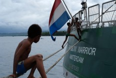 Floating playground: Children play around the ship as it is anchored at Manokwari port in West Papua. JP/ Jerry Adiguna