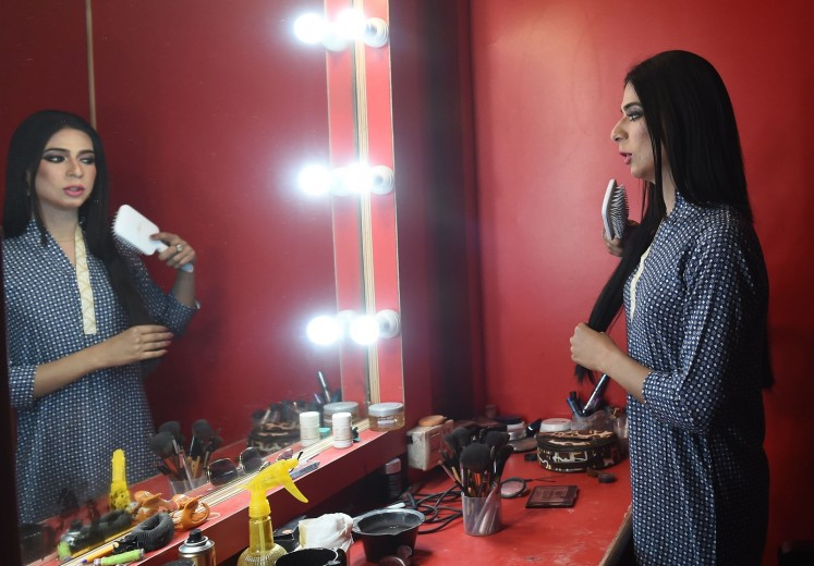 In this photograph taken on March 27, 2018, Pakistan's first transgender news anchor Marvia Malik, 21, prepares before going live to read the news for the private channel Kohenoor in Lahore.
