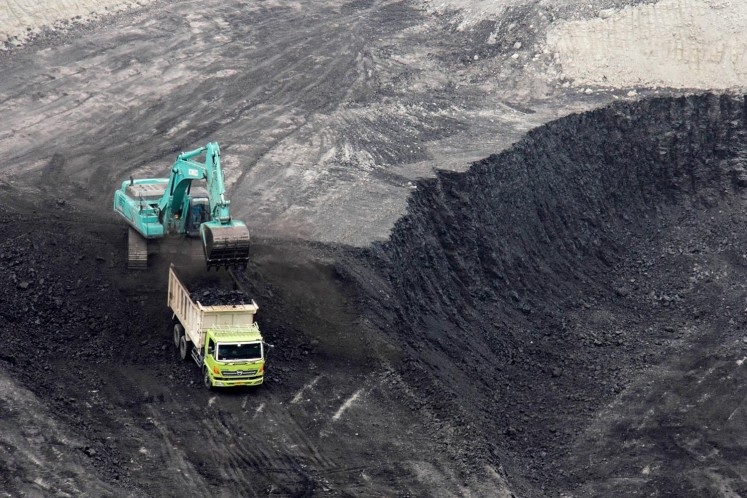 Coal is loaded into a haul truck at a coal mine in South Sumatra.