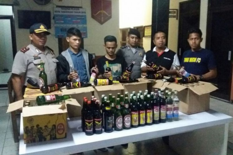 Tangerang City Police in Banten show confiscated alcoholic drinks after raiding jamu (herbal drink) stalls suspected of selling bootleg liquor on April 4.