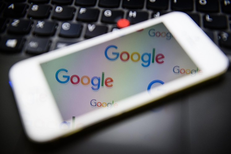 The logo for US technology company and search engine Google is displayed on screens in London on February 11, 2016. 