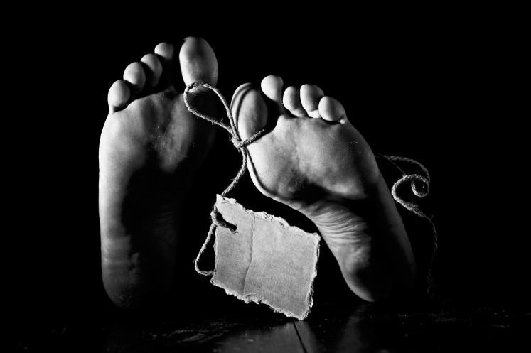 Dead body found in suitcase in Bogor
