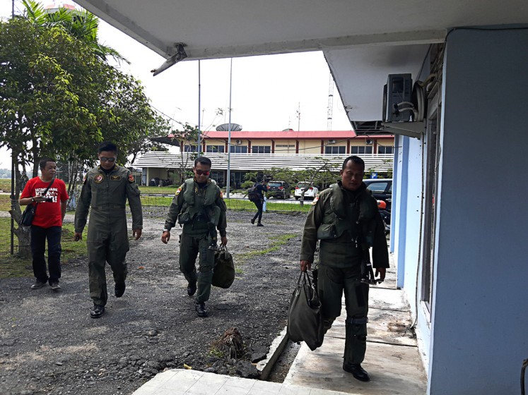 On a mission: Indonesian Air Force pilots walk at Hang Nadim International Airport in Batam. Opened in 1945, the airport is equipped with a runway of 4,025 meters, the second-longest runway in South East Asia, after that of Kuala Lumpur International Airport.