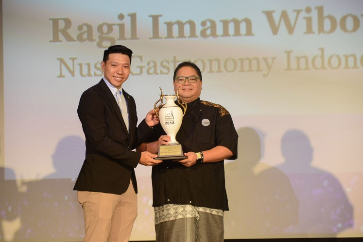 Ragil Imam Wibowo of Nusa Indonesian Gastronomy receives the award of excellence at the World Gourmet Summit 2018.