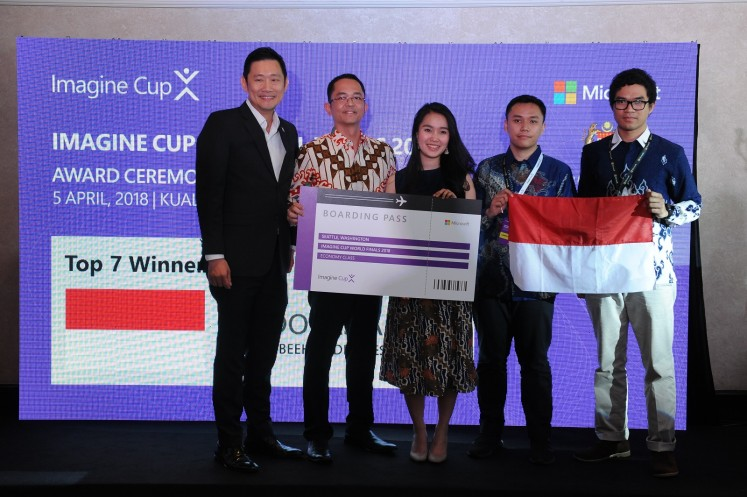 Kevin Wo, managing director of Microsoft in Singapore, and Haris Izmee, president director of Microsoft in Indonesia, have a picture taken with Anindita Pradana Suteja, Muhamad Randi Ritvaldi and Ishak Hilton Pujantoro Tnunay at the Imagine Cup awards gala in Kuala Lumpur.