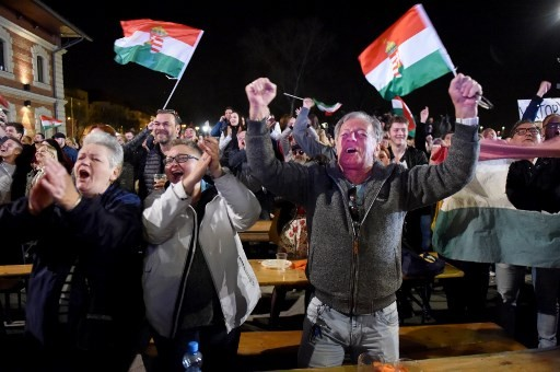 Hungary's PM Orban claims victory as his party takes sweeping poll lead