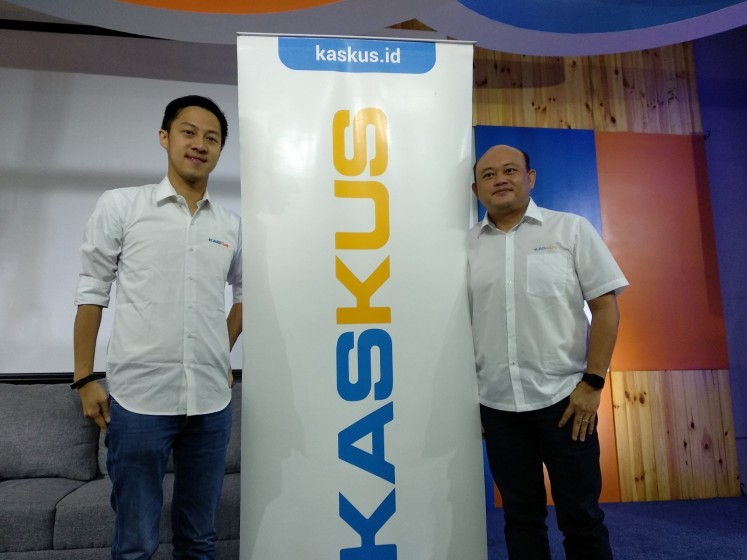Kaskus co-founder Andrew Darwis (left) poses with newly appointed Kaskus CEO Edi Taslim (right) at the company's office in South Jakarta on April 9.