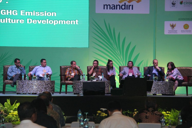 A panel discussion at ICOPE 2016 on Oil Palm Development and GHG Emission: Slash and Burn Practice in Agriculture development with CIFOR Indonesia, Head of District Seruyan, SPKS, GAPKI and WRI.