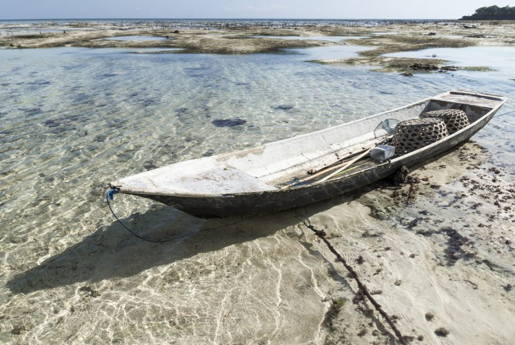 Abandoned boat at the seagrass plantation at Nusa Lembongan, Bali, Indonesia.