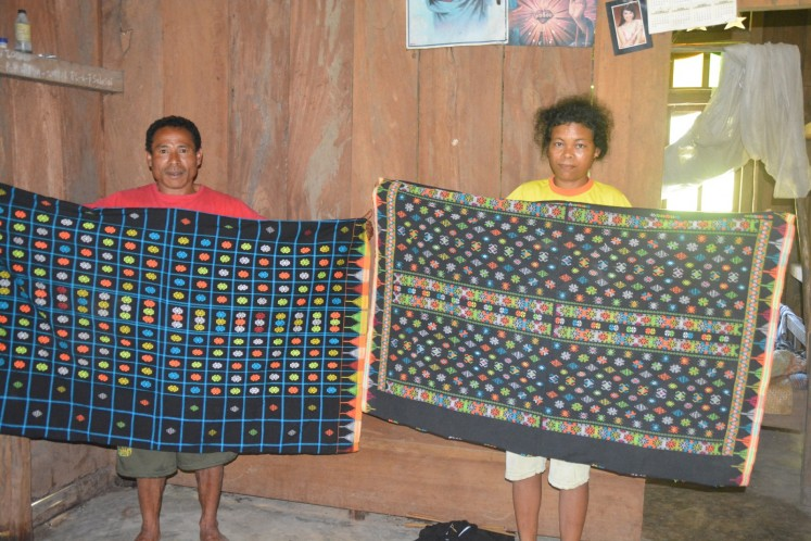 Women in East Manggarai, Flores, show off their 'rembong' woven fabrics.