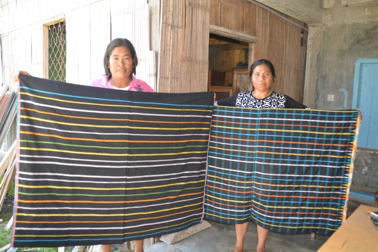 Women in East Manggarai, Flores, display 'congkar' woven fabrics.