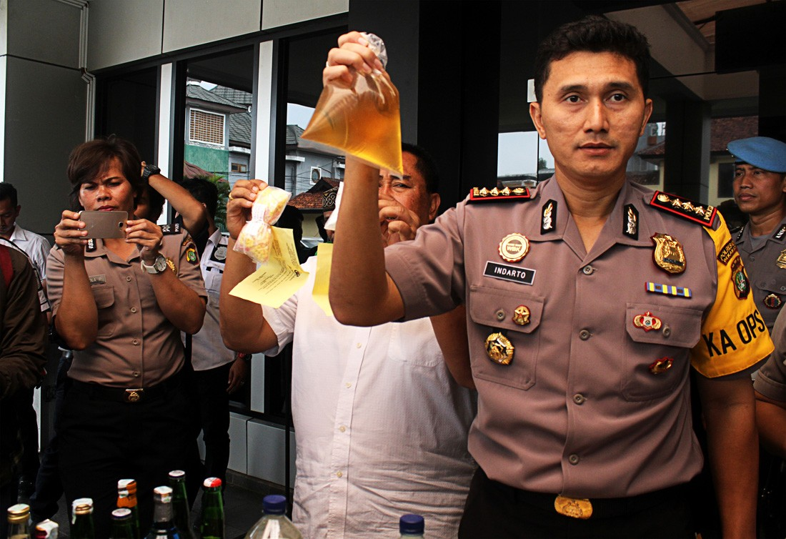 Police vow to stamp out bootleg liquor by Ramadhan