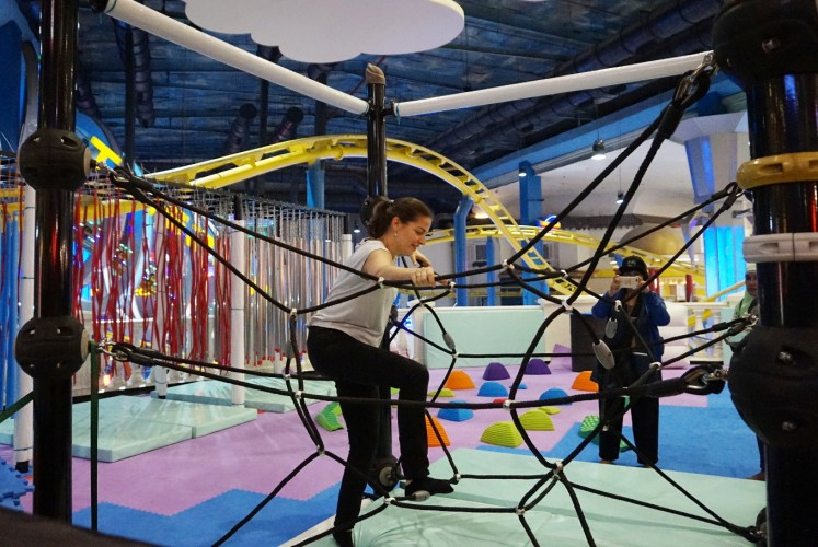Emmaline Tsang, playground designer of Explora Playground, tries one of the attractions at Space Explora at Supermall Karawaci in Tangerang, Banten.