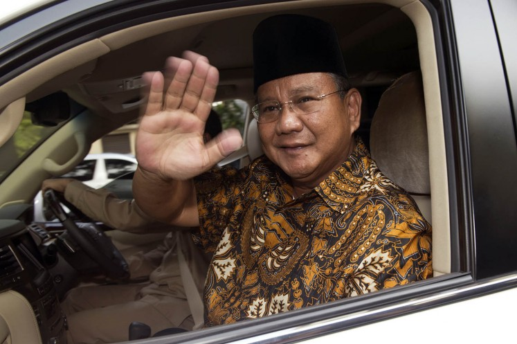 Indonesian presidential candidate Prabowo Subianto gestures to journalists following a meeting with Islamic organizations in Jakarta on July 15, 2014.
