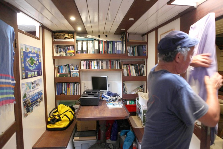 Sanctuary: A ship volunteer tidies up its working room.