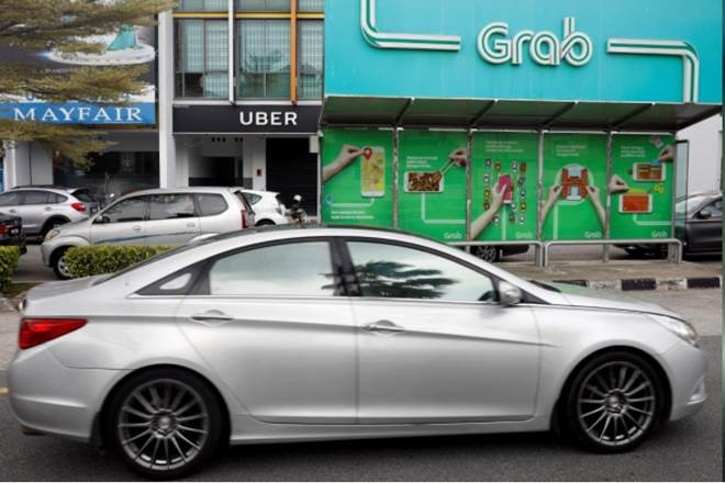 Singapore proposes fines on Grab, Uber, says merger harms competition
