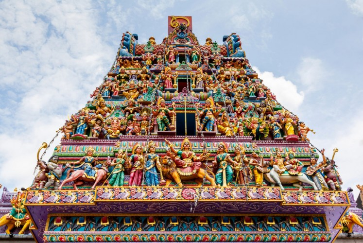 Intricate Hindu art and deity carvings on the facade of Sri Veeramakaliamman Temple in Little India, Singapore