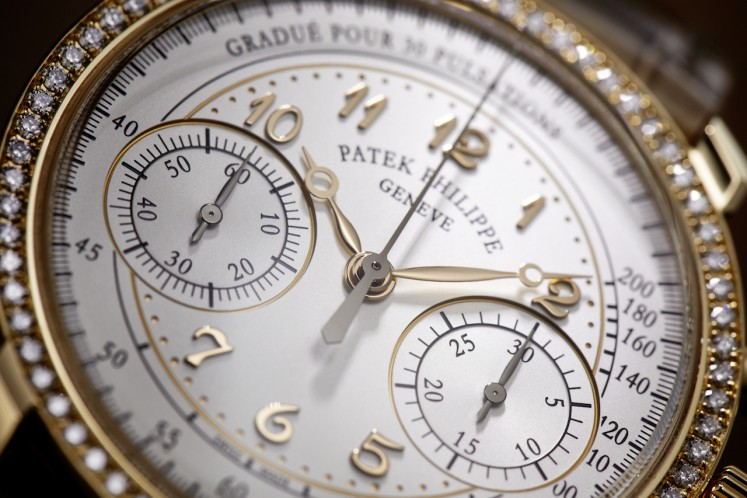 The silvery opaline dial of Patek Philippe's new Ladies First Chronograph, with applied Breguet numerals in 18K rose gold.
