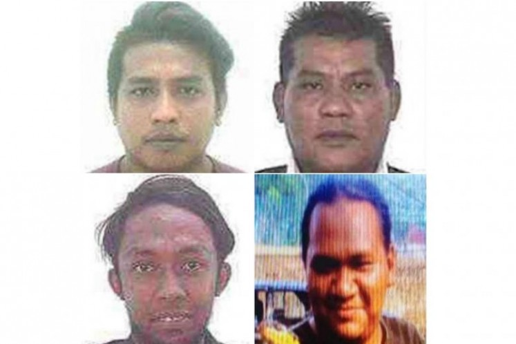Clockwise from top left: The suspects listed were named as Muhamad Faizal Muhamad Hanafi, Muhamad Hanafi Yah, both of whom are from Kelantan state, Awae Wae-Eya, a Thai national living in southern Thailand and Nor Farkhan Mohd Isa, whose address was given as being in southern Johor.