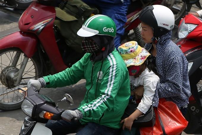 Watchdog probes Grab's Uber buy in Vietnam