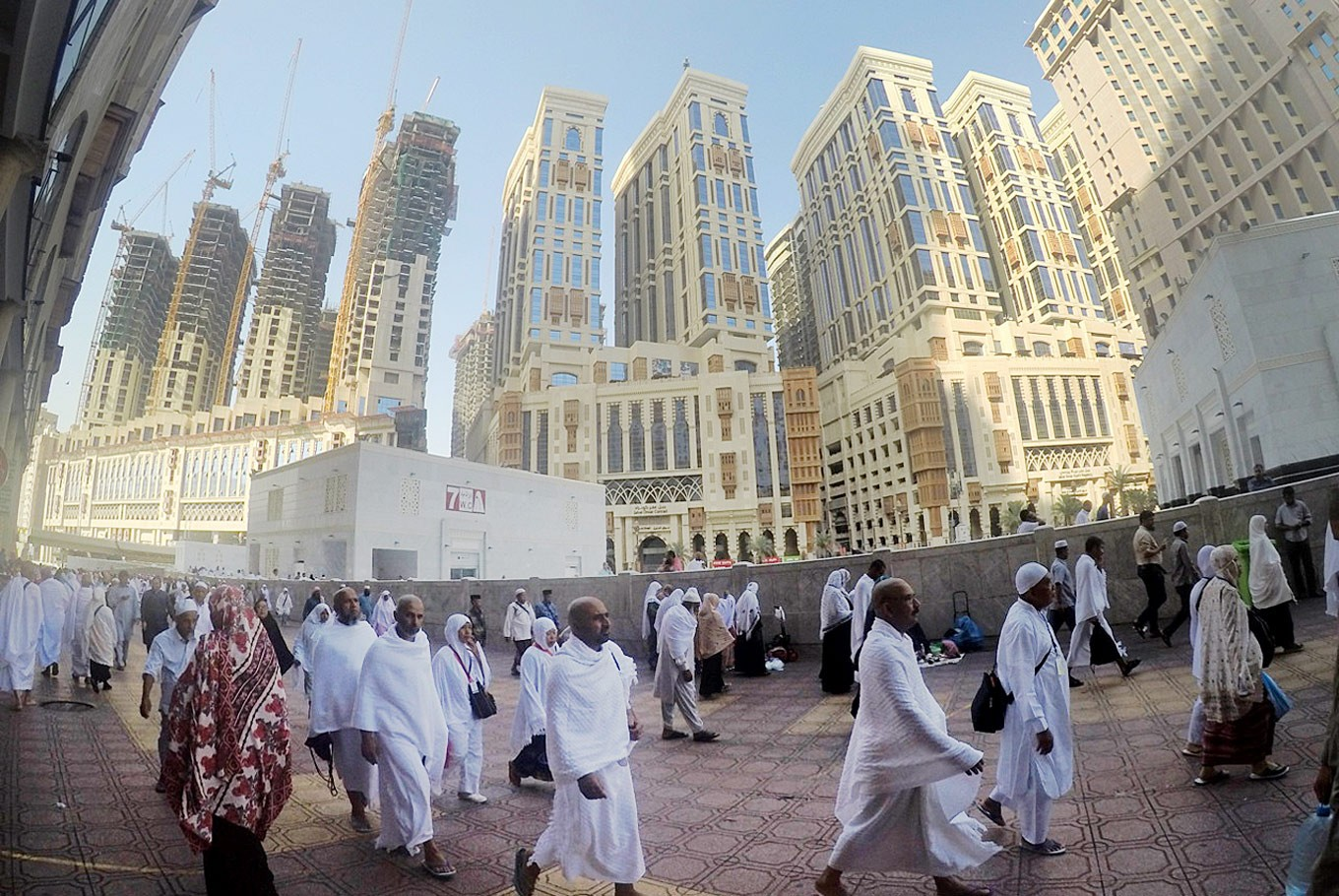 Rising up: New high-rise buildings stand in Mecca as the city is increasing its capacity to accommodate more pilgrims. The Saudi Arabian monarchy plans to welcome some 30 million pilgrims a year, both for the haj and the year-round umrah, by 2030.