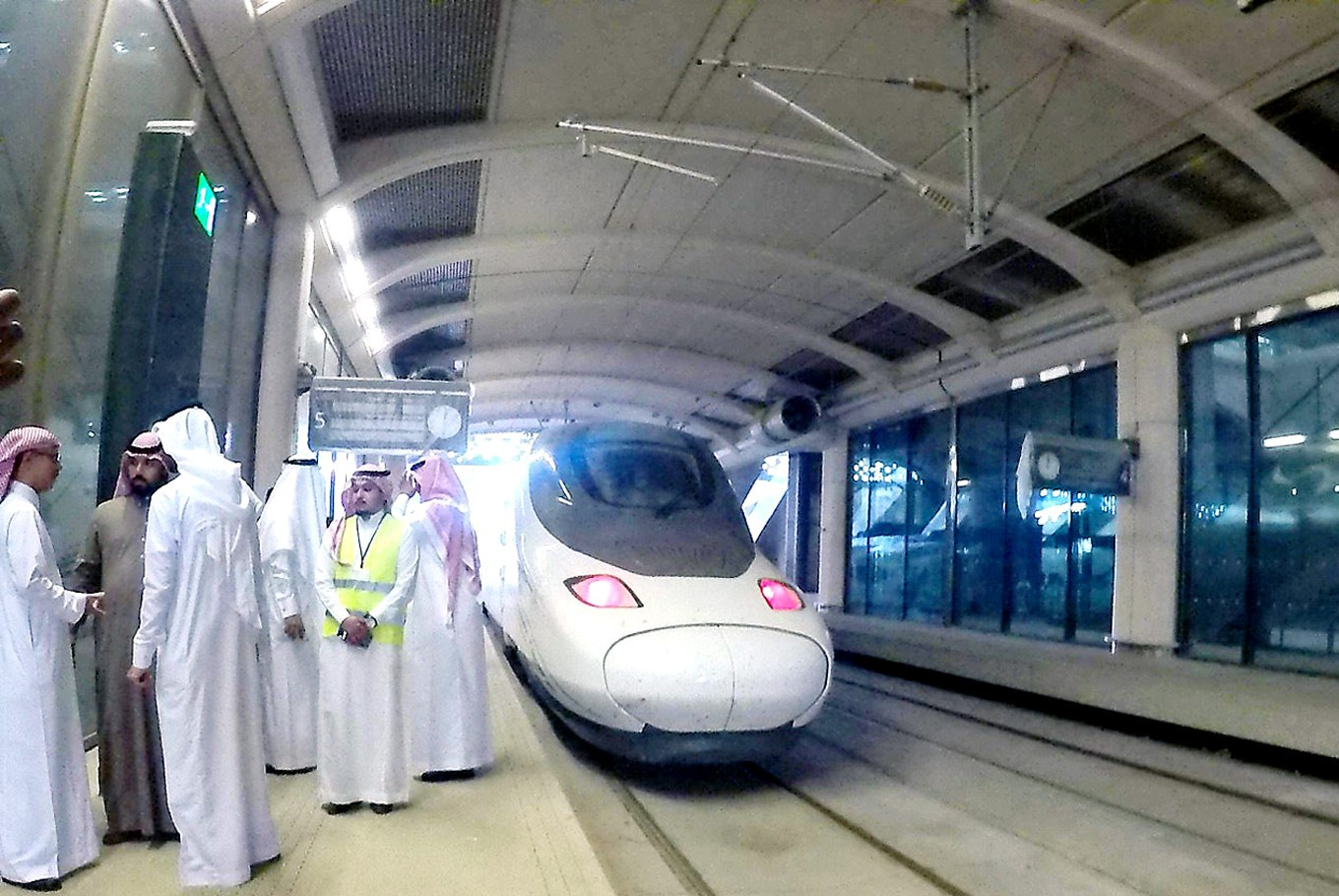 All aboard: Saudi Arabian officials inspect the bullet train at King Abdullah Economic City Station, one of five stops of the Haramain high-speed rail service between Mecca and Medina.