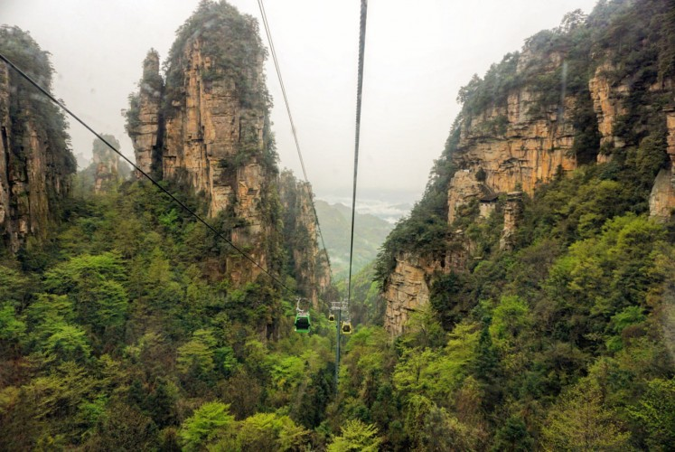 A cable car takes visitors through the heart of the Zhangjiajie National Forest Park.