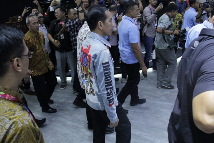 Looking stylish: President Joko Widodo wears a denim jacket with a map of Indonesia emblazoned across the chest.