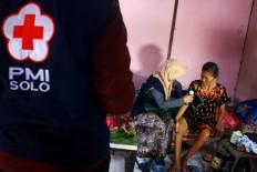 A doctor examines an elderly patient. JP/Maksum Nur Fauzan