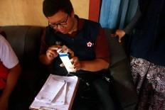 A doctor checks medical supplies. JP/Maksum Nur Fauzan