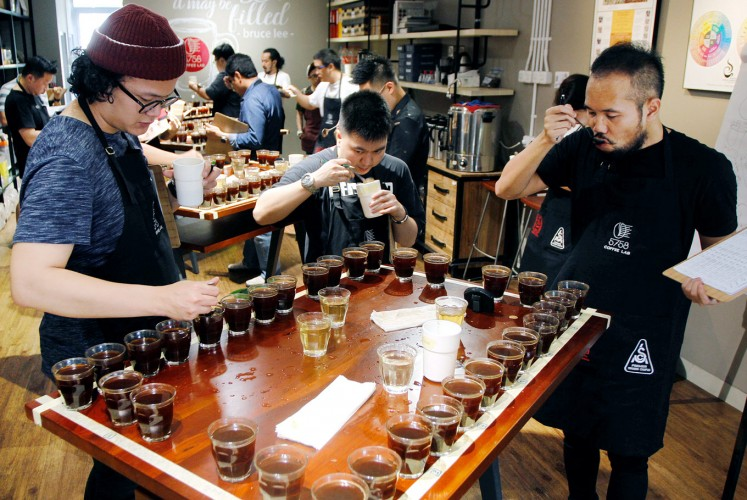 Team work: Coffee cuppers are divided into groups of three during a Sensory Education Training session at 5758 Coffee Lab.