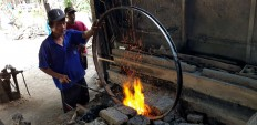 Traditional tools: An iron wheel frame needs to be heated constantly during the forging process. JP/R. Berto Wedhatama