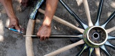 Measuring point: An andong repairmen uses a pencil to put marks on a wheel that is being fixed. JP/R. Berto Wedhatama