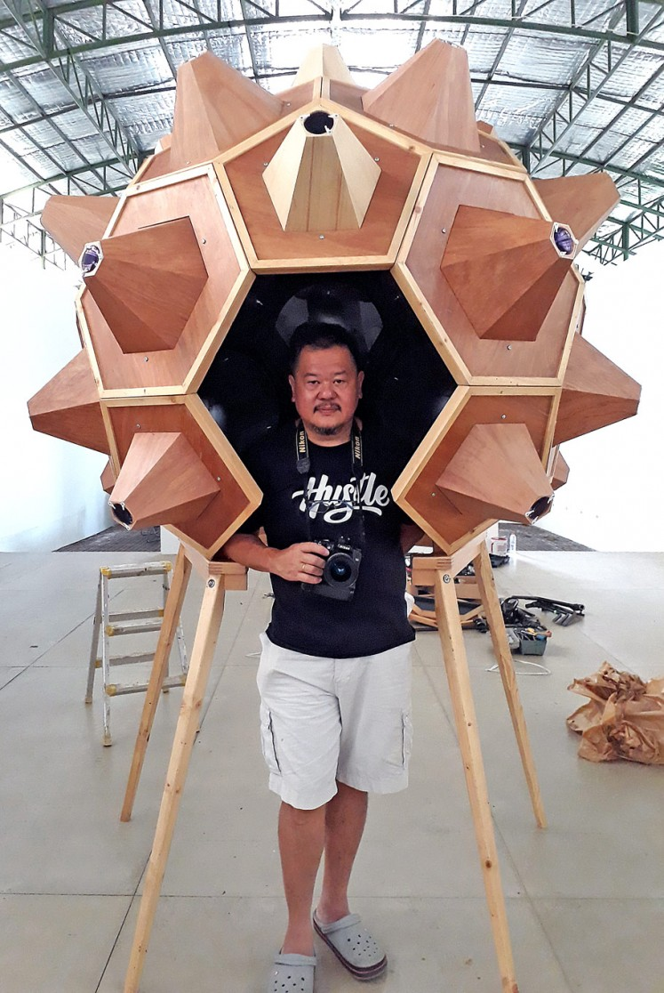 Exploration: The I Can See the World camera obscura installation is made of plywood and acrylic.