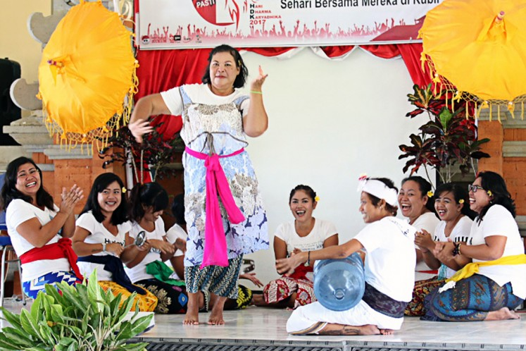 In joy and happiness: A female prisoner performs a Balinese traditional dance during Correctional Day celebrations at Bangli prison on April 25.