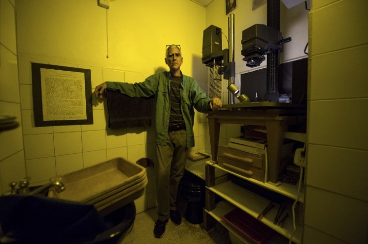 Rodrigo Benavides a 58-year-old Venezuelan darkroom technician poses for a picture at his darkroom in Caracas on April 19, 2018.