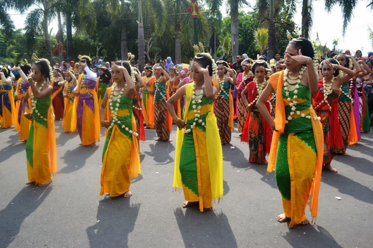 Cultural preservation: Dozens of female students perform gambyong, a Javanese traditional dance, during Solo Menari 2017 in Surakarta, Central Java.
