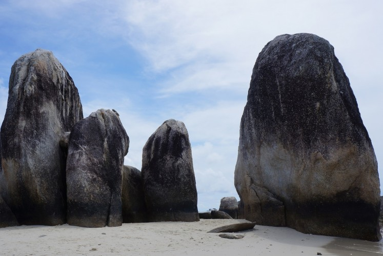 Giant boulders line the shores as iconic geographical features of Batu Berlayar Island (Belitung Island).
