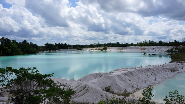 Once the site of a mine, Kaolin Lake in Tanjung Pandan, Belitung regency, offers a cool vista of its turquoise waters.