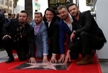 With fans aflutter, boy band 'NSync 'reunites' for Hollywood star
