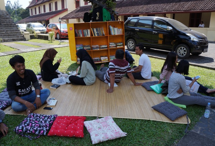 Visitors of #BarruMembaca lounge near the mobile library.