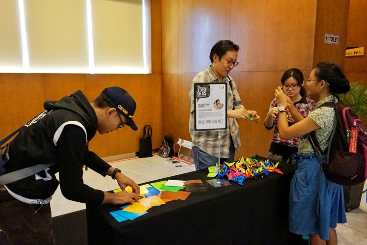 Participants fold paper cranes in a provided space at the Writers' Series event in Central Jakarta on May 5.