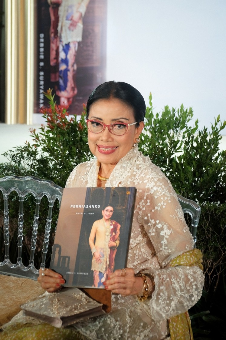 Mien R Uno poses with her new book, 'Perhiasanku'.
